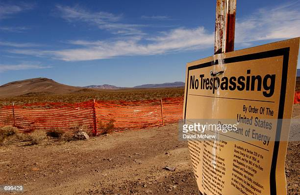 A no trespassing sign warns people to stay away from the proposed nuclear waste dump site of Yucca Mountain February 7 2002 at Nellis Air Force Base...