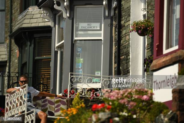 """No Vacancies"" signs are pictured in windows of guest houses in Keswick in the Lake District in north west England on August 14 as many people take..."
