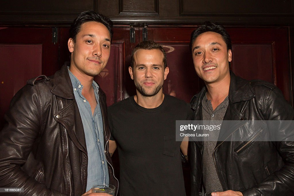 No Vacancy co-owners Mark Houston (L) and Jonnie Houston (R) pose with singer Anthony Gonzalez of M83 (C) at the M83 Post-Show Soiree At No Vacancy on September 22, 2013 in Hollywood, California.