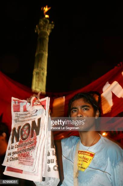 A 'no' vote supporter displays a poster reading 'No To European Constitution To Goverment And To Chirac' in front of the Bastille column after French...