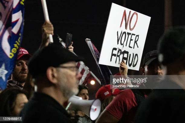 No voter fraud sign is displayed by a protester in support of President Donald Trump at the Maricopa County Elections Department office on November...