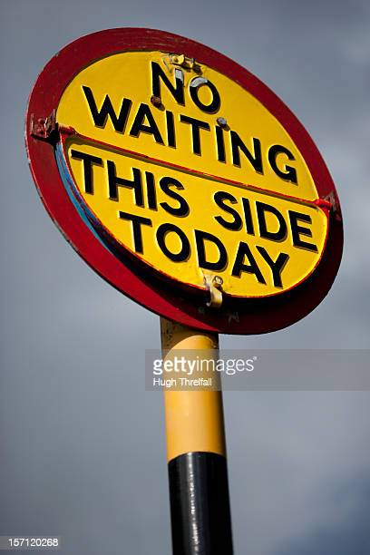 no waiting this side today sign - hugh threlfall stock pictures, royalty-free photos & images