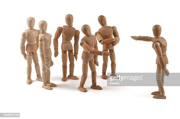 No! You! - wooden mannequin team in discussion