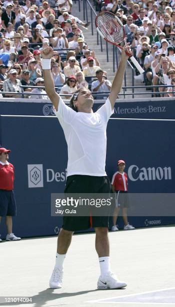 No.1 seed Roger Federer raises his arms in the air after defeating Richard Gasquet of France in the final of the Rogers Cup ATP Master Series tennis...