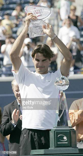 No1 seed Roger Federer raises the winners trophy after defeating Richard Gasquet of France in the final of the Rogers Cup ATP Master Series tennis...
