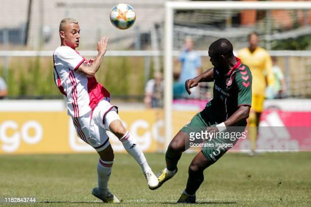 Noa Lang of Ajax, Jores Okore of Aalborg BK during the match between Ajax v Aalborg on June 29, 2019 in Oldenzaal Netherlands