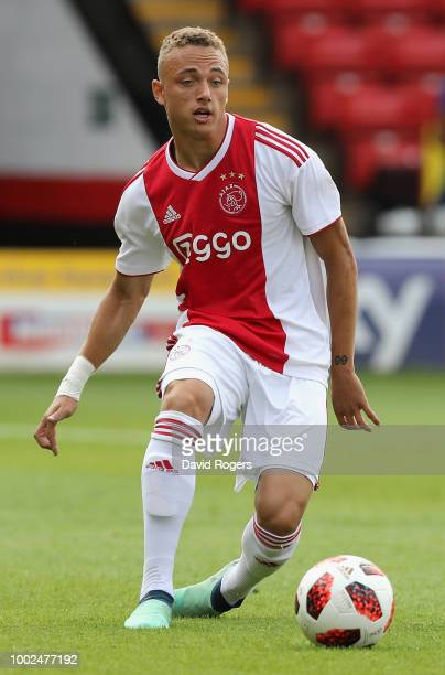 Noa Lang of Ajax passes the ball during the pre seaon friendly match between Wolverhampton Wanderers and Ajax at the Banks' Stadium on July 19 2018...