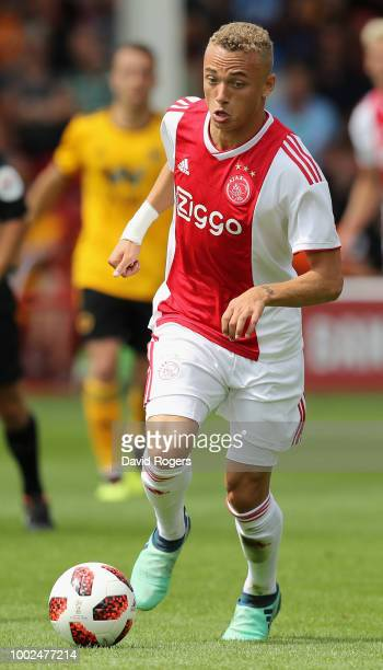 Noa Lang of Ajax runs with the ball during the pre seaon friendly match between Wolverhampton Wanderers and Ajax at the Banks' Stadium on July 19...