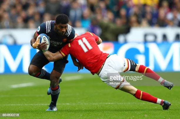 Noa Nakaitaci of France is tackled by Liam Williams of Wales during the RBS Six Nations match between France and Wales at the Stade de France on...