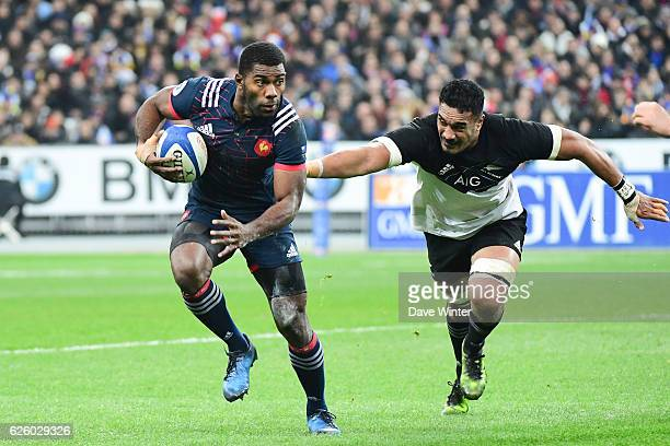 Noa Nakaitaci of France takes on Jerome Kaino of New Zealand during the test match between France and New Zealand at Stade de France on November 26...