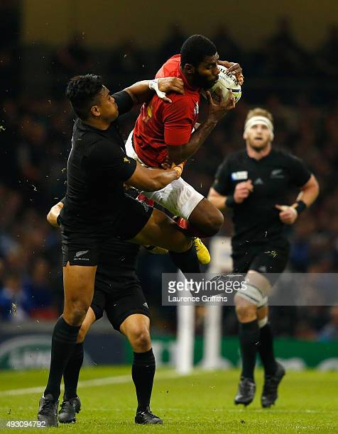 Noa Nakaitaci of France takes the ball under the challenge of Julian Savea of the New Zealand All Blacks during the 2015 Rugby World Cup Quarter...