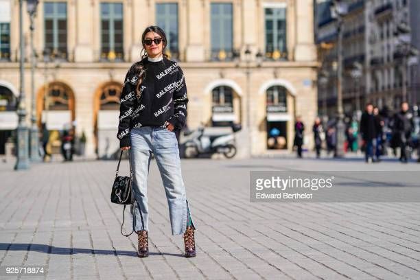 Noa Souffir wears a Balenciaga top flare jeans a bag sunglasses during Paris Fashion Week Womenswear Fall/Winter 2018/2019 on February 28 2018 in...