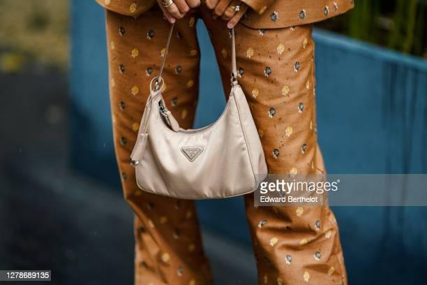 Noa Souffir wears a brown blazer jacket, suit flared pants, a Prada bag, outside Paul & Joe, during Paris Fashion Week - Womenswear Spring Summer...