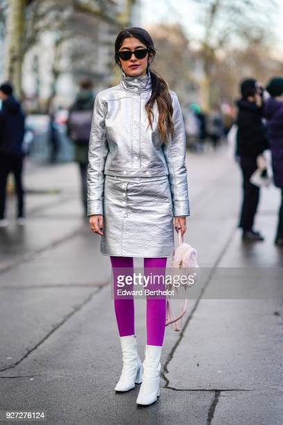 Noa Souffir wears a silver glitter dress sunglasses purple leggings white shoes outside Valentino during Paris Fashion Week Womenswear Fall/Winter...