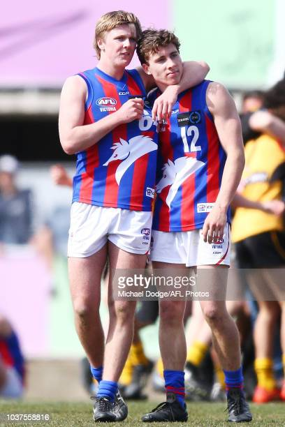 Noah Ainsworth of the Oakley Chargers looks dejected when hugged by James Jordan after defeat during the 2018 TAC Cup Grand Final match between...