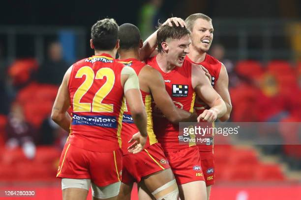Noah Anderson of the Suns celebrates a goal during the round 10 AFL match between the Gold Coast Suns and the St Kilda Saints at Metricon Stadium on...