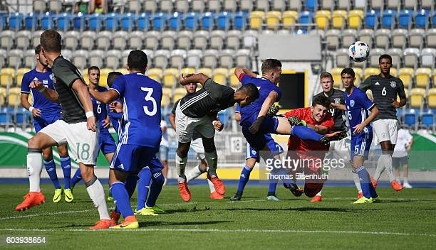 Noah Awuku of Germany with a header against goalie Roei Maoz and Eden Karzev of Israel during the Under 17 four nations tournament match between U17...