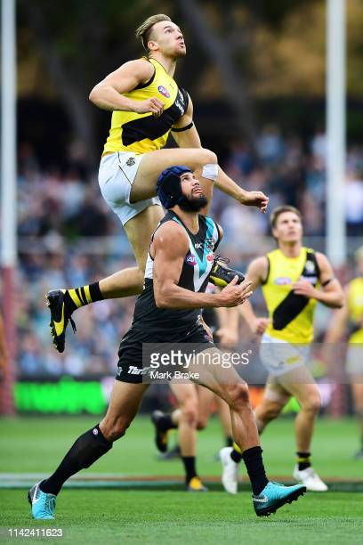 Noah Balta of the Tigers rucks over Paddy Ryder of Port Adelaide during the round four AFL match between the Port Adelaide Power and the Richmond...