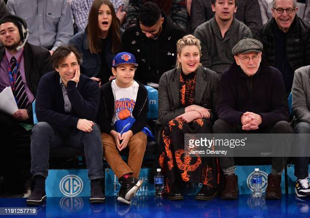 Noah Baumbach Rohmer Baumbach Greta Gerwig and guest attend Portland Trail Blazers v New York Knicks game at Madison Square Garden on January 1 2020...