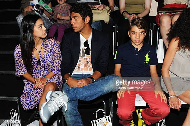 Noah Becker and his girlfriend Rafaela Remy Sanchez with his brother Elias Balthasar Becker attend the Perret Schaad Show during MercedesBenz Fashion...