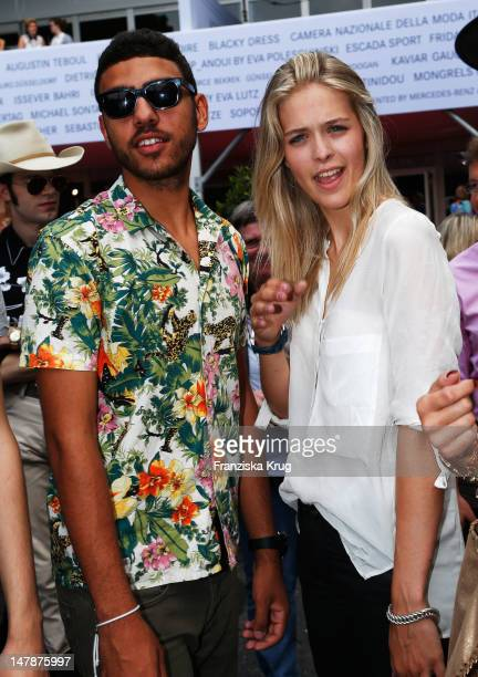 Noah Becker and Laura Zurbriggen arrive for the Laurel Show at the MercedesBenz Fashion Week Spring/Summer 2013 on July 5 2012 in Berlin Germany