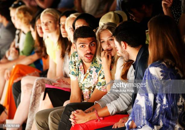 Noah Becker and Laura Zurbriggen sit in a front row the runway at the Laurel Show during the MercedesBenz Fashion Week Spring/Summer 2013 on July 5...