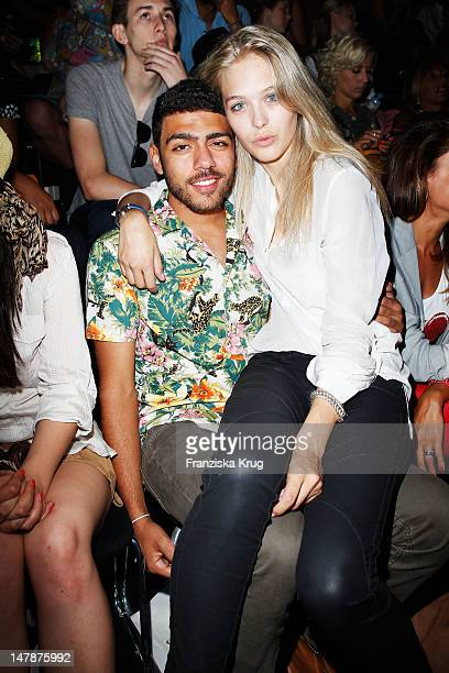 Noah Becker and Laura Zurbriggen sit in front row during the Laurel Show during the MercedesBenz Fashion Week Spring/Summer 2013 on July 5 2012 in...