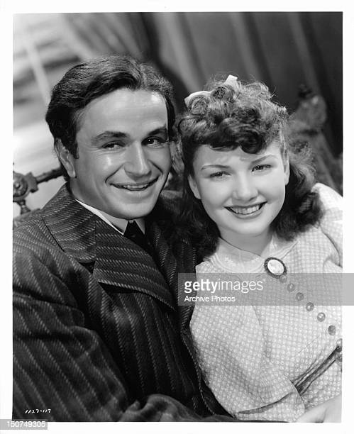Noah Beery Jr with his arm around Anne Baxter in a scene from the film '20 Mule Team' 1940