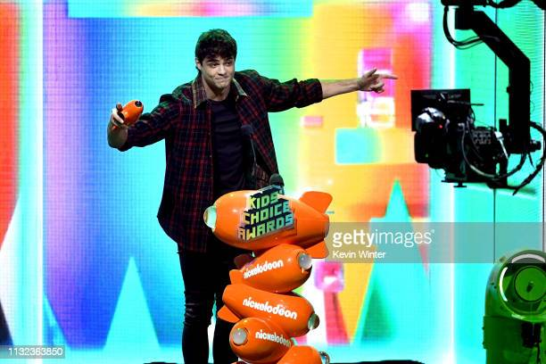 Noah Centineo accepts the Favorite Movie Actor award for 'To All the Boys I've Loved Before' onstage at Nickelodeon's 2019 Kids' Choice Awards at...