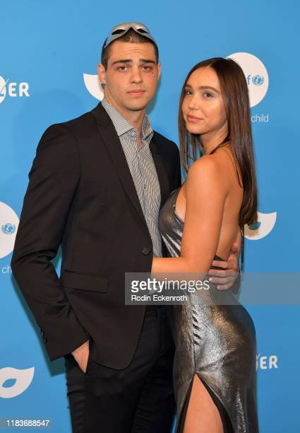 Noah Centineo and Alexis Ren attend the UNICEF Masquerade Ball at Kimpton La Peer Hotel on October 26 2019 in West Hollywood California