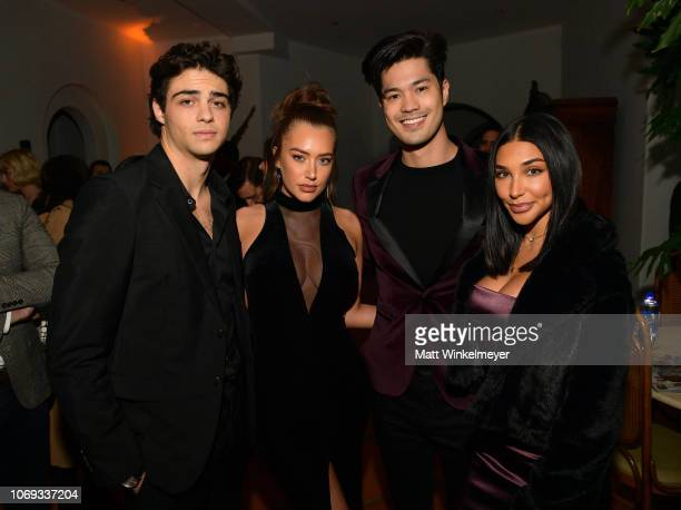 Noah Centineo guest Ross Butler and Chantel Jeffries attend the 2018 GQ Men of the Year Party at a private residence on December 6 2018 in Beverly...