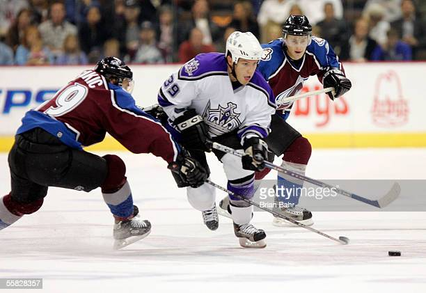 Noah Clarke of the Los Angeles Kings works his way around Joe Sakic of the Colorado Avalanche in the second period on September 29 2005 at the Pepsi...