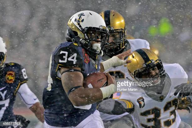 Noah Copeland of the Navy Midshipmen runs for a touchdown in the second quarter during a game against the Army Black Knights on December 14 2013 at...