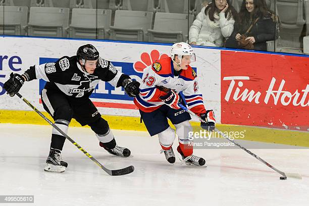 Noah Corson of the Moncton Wildcats skates the puck against Matthew Thorpe of the Blainville-Boisbriand Armada during the QMJHL game at the Centre...