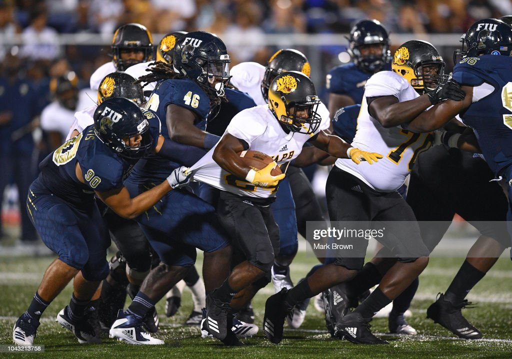 newest 43955 597b1 Noah Curtis of the FIU Golden Panthers grabs the jersey of ...