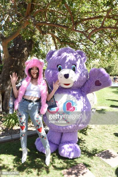 Noah Cyrus and a Care Bear attend Lucky Lounge Presents Desert Jam on April 15 2017 in Palm Springs California