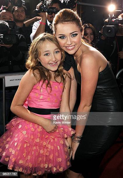 Noah Cyrus and actress/singer Miley Cyrus arrive at the premiere of Touchstone Picture's 'The Last Song' held at ArcLight Hollywood on March 25 2010...