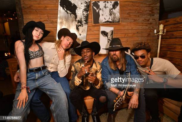 Noah Cyrus Diplo Lil Nas X Billy Ray Cyrus and YoungKio pose for a portrait backstage during the 2019 Stagecoach Festival at Empire Polo Field on...
