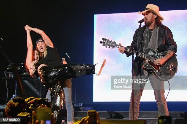 Noah Cyrus Miley Cyrus and Billy Ray Cyrus perform onstage during Katy Perry 'Witness The Tour' at Madison Square Garden on October 6 2017 in New...