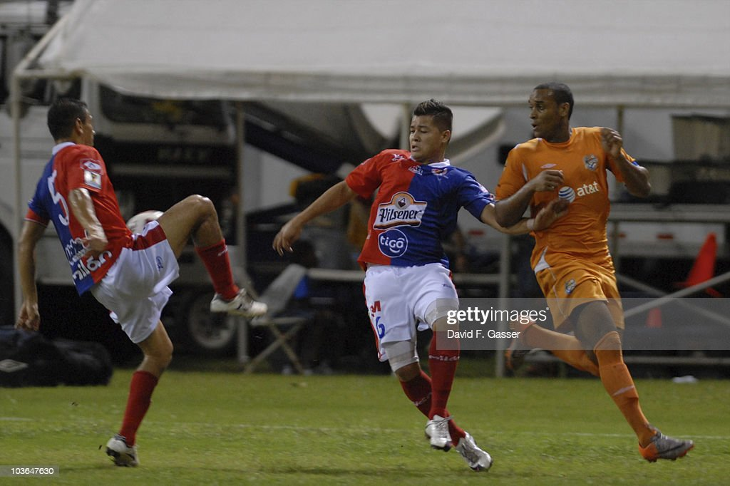 Noah Delgado (L) and Alexis Rivera (C) of FAS vie for the ball with Nicholas Adderly of Islanders during their match as part of 2010 CONCACAg Champions League at Juan Ramon Loubriel Stadium on August 25, 2010 in Baymon, Puerto Rico.