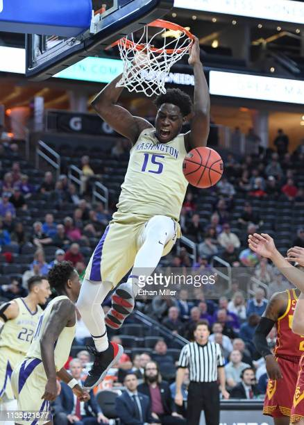 Noah Dickerson of the Washington Huskies dunks against the USC Trojans during a quarterfinal game of the Pac12 basketball tournament at TMobile Arena...
