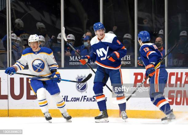 Noah Dobson of the New York Islanders celebrates his goal at 10:25 of the first period against the Buffalo Sabres and is joined by Mathew Barzal at...