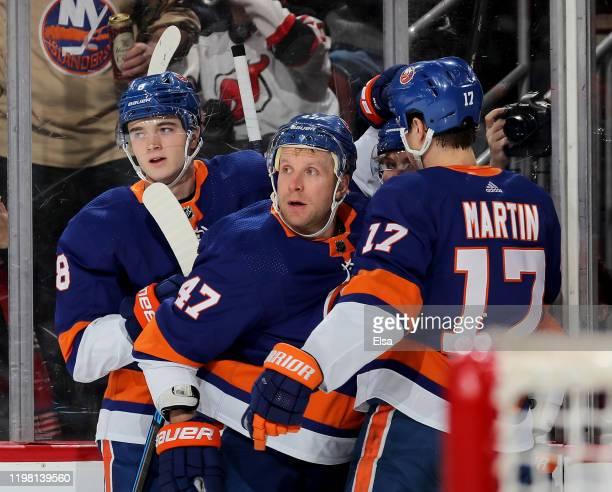 Noah Dobson,Leo Komarov and Matt Martin of the New York Islanders congratulate teammate Casey Cizikas after he scored a goal in the first period...