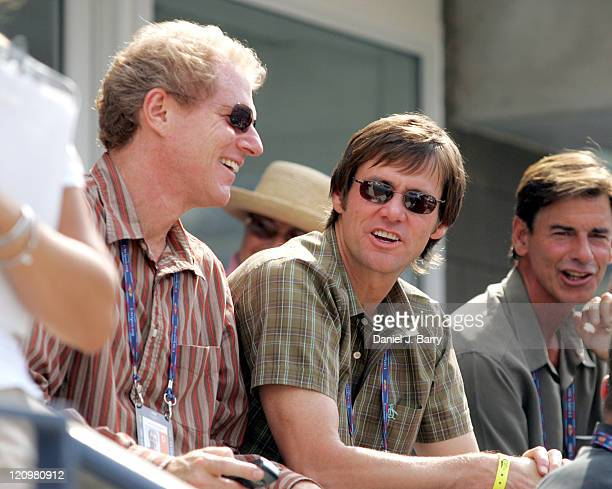 Noah Emmerich and Jim Carrey watch a match on the first day of the 2005 US Open at the USTA National Tennis Center in Flushing New York on August 29...