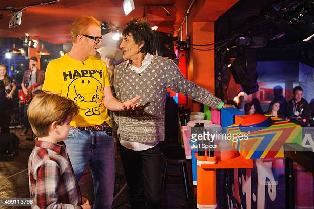 Noah Evans and Chris Evans and Ronnie Wood during a live broadcast of 'TFI Friday' on November 27 2015 in London England