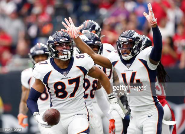 Noah Fant of the Denver Broncos celebrates his touchdown in the first quarter with teammate Courtland Sutton in the first quarter against the Houston...