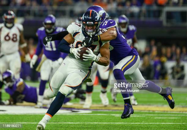 Noah Fant of the Denver Broncos is tackled with the ball by Anthony Barr of the Minnesota Vikings in the fourth quarter of the game at US Bank...