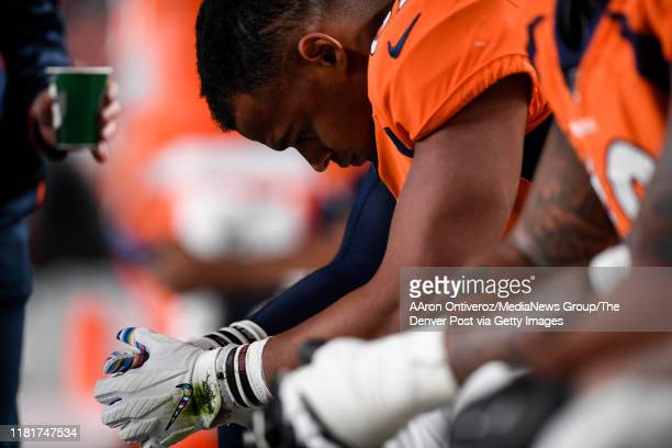 Noah Fant of the Denver Broncos reacts to dropping a third-down pass from Joe Flacco against the Kansas City Chiefs during the third quarter on...