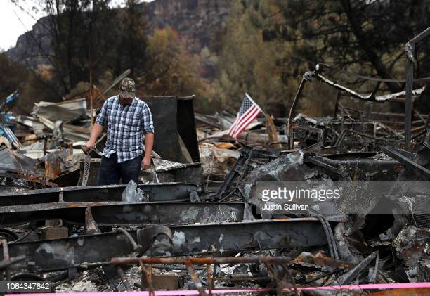 Noah Fisher looks over his home that was destroyed by the Camp Fire on November 22 2018 in Paradise California Fueled by high winds and low humidity...