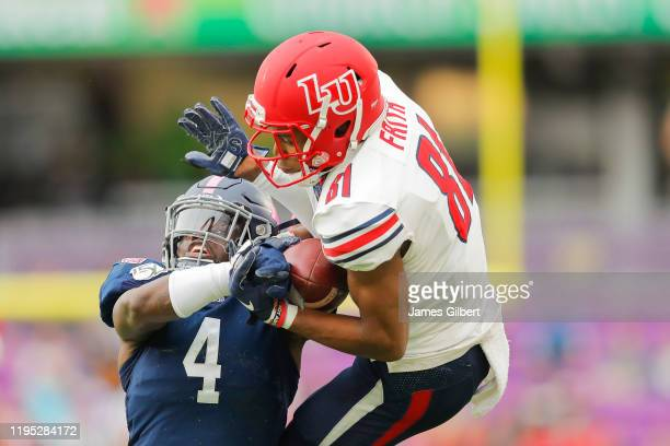 Noah Frith of the Liberty Flames catches a pass against Monquavion Brinson of the Georgia Southern Eagles during the second quarter in the 2019 Cure...